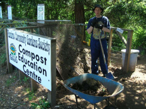 A long time volunteer, Kelly, sifts compost in the compost education centre at the demonstration garden