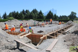 VIU Carpentry students level cement in forms